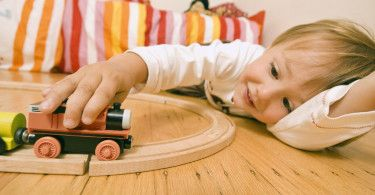 Boy playing with toy train